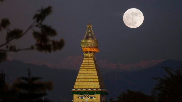 the-supermoon-is-seen-here-above-the-boudhanath-stupa-in-kathmandu-nepal